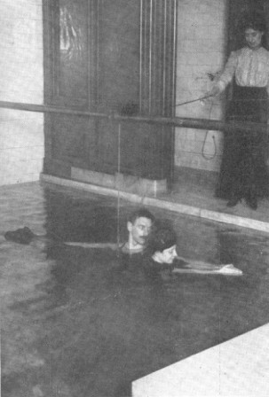 THE BREAST STROKE—TEACHING WITH TROLLEY AND INSTRUCTOR